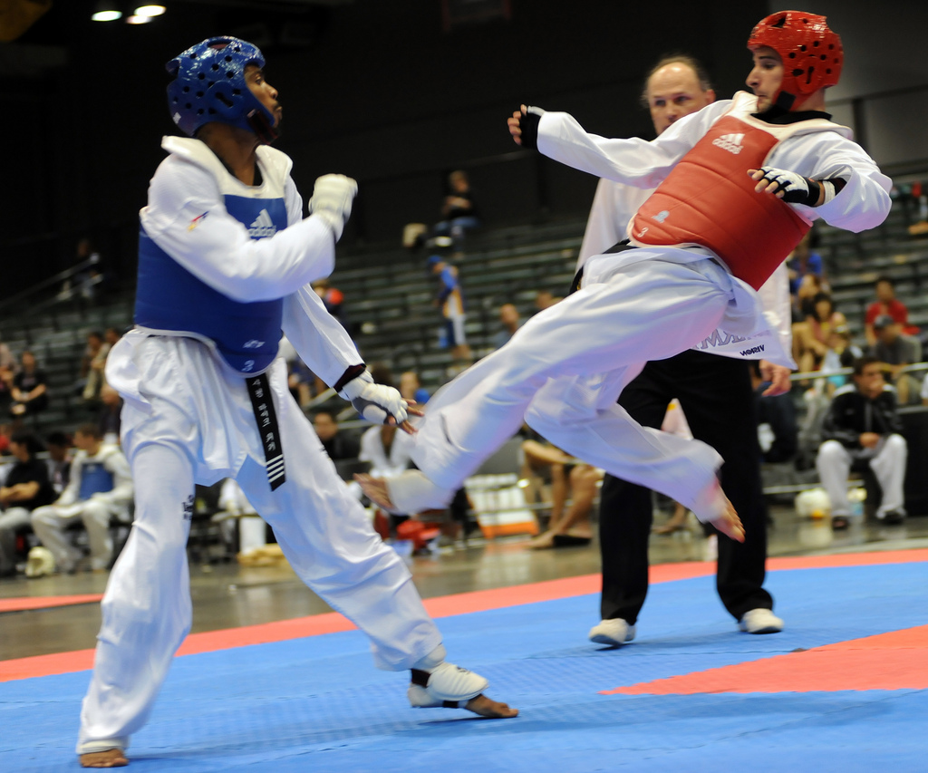 0982-RiderKicksWalker8777.jpg: U.S. Army World Class Athlete Program martial artist Sgt. William Rider kicks Michigan's Michael Walker en route to a 4-2 victory July 5 at the 2009 U.S. National Taekwondo Championships at Austin Convention Center in Texas. Rider won a silver medal in the featherweight division. Photo by Tim Hipps, FMWRC Public Affairs